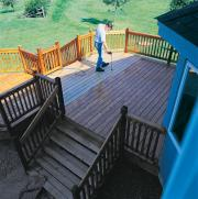 Man spraying deck