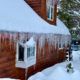 Winter home covered in snow and ice