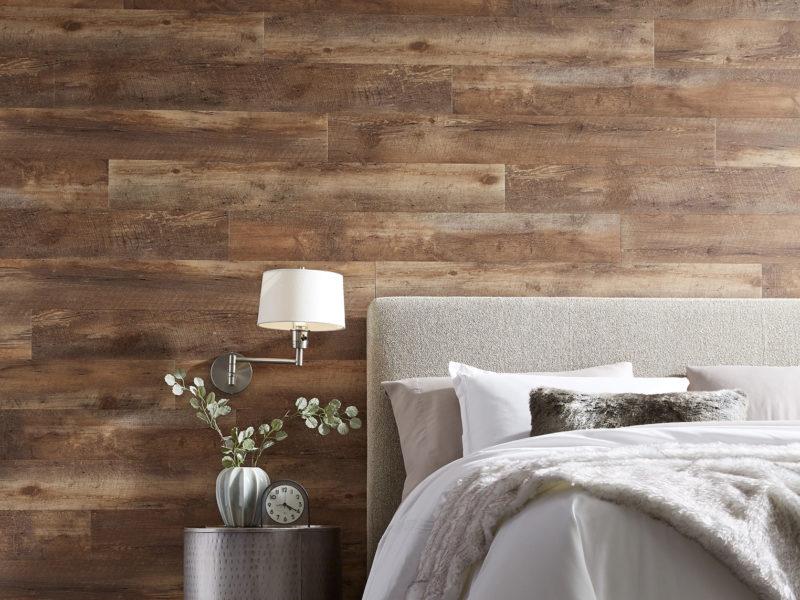 wood floor used on wall behind bed