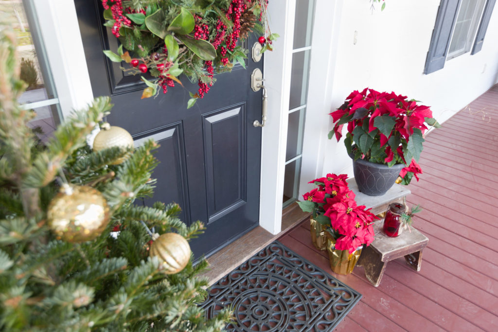 Gray front door decorated for the holidays