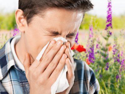 Man sneezing from allergies