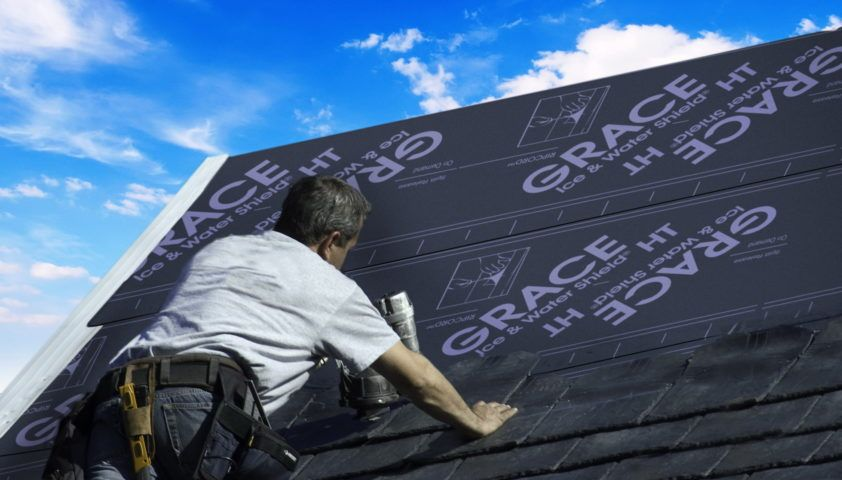 Roofer Installing Ice and Water Shield