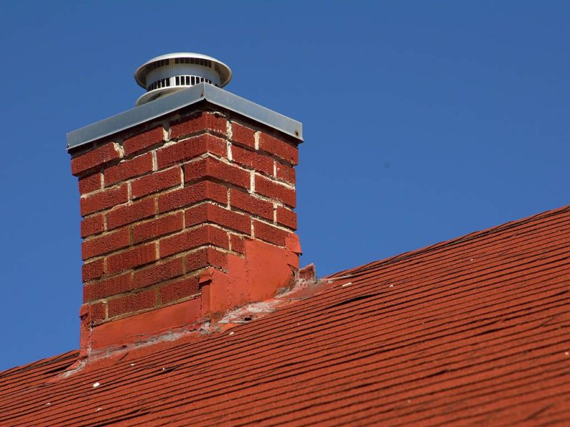Chimney on a red roof