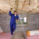 Man installing floor insulation