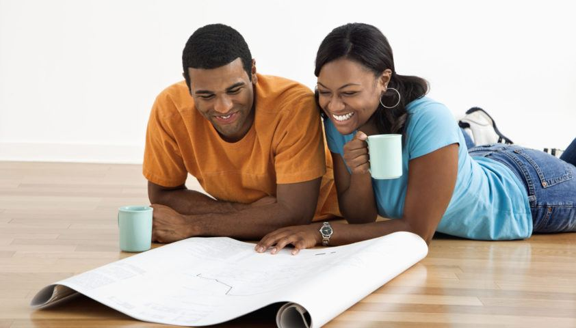 Couple with blueprints.