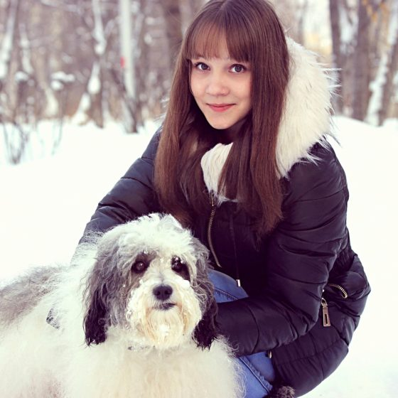 Dog and Woman Outside in Winter