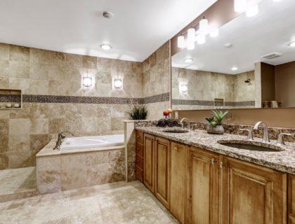 Luxury bathroom interior with tile floor.