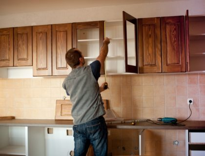 carpenter_contractor_install_installing_installation_new_kitchen_cabinets_shutterstock_43156006