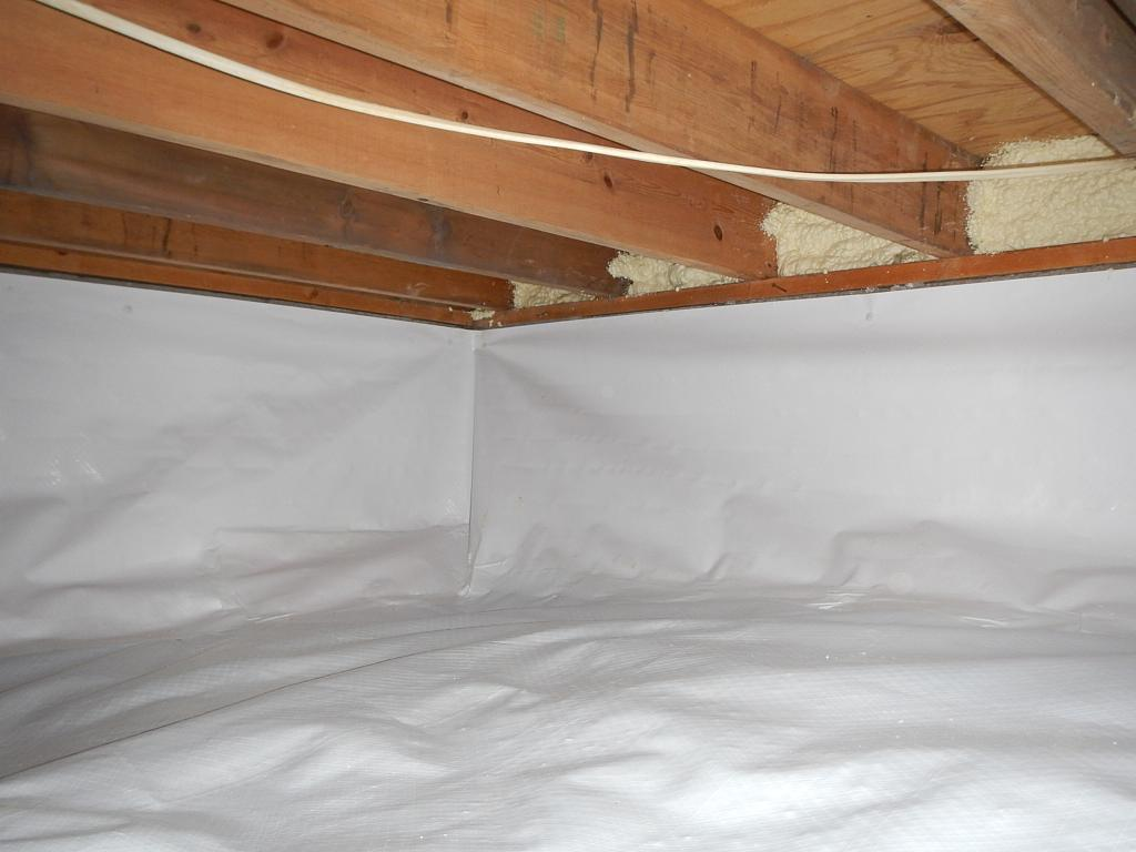 Crawlspace under a house with vapor barrier installed