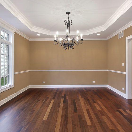 dark_wood_wooden_hardwood_flooring_floor_laminate_chandelier_dining_room_new_house_shutterstock_48327793