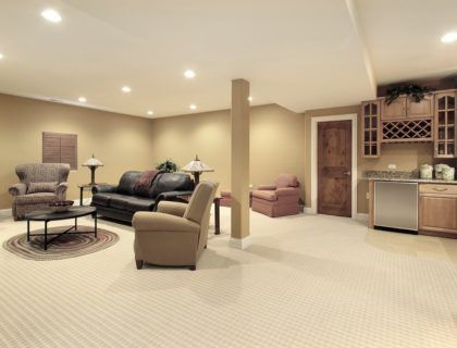 finished_basement_kitchen_lower_level_below_grade_carpeting_furniture_shutterstock_27628933