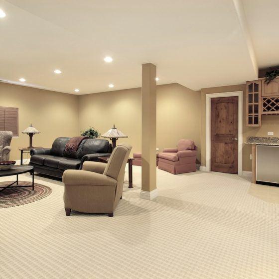finished_basement_kitchen_lower_level_below_grade_carpeting_furniture_shutterstock_27628933