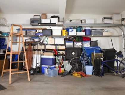 garage_messy_ladder_shelves_shelving_storage_organization_cluttered_shutterstock_59550292