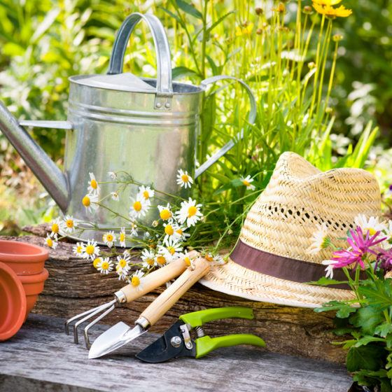 garden_gardening_gardener_tools_sun_hat_straw_hat_flower_pots_spade_rake_dig_shutterstock_107822084