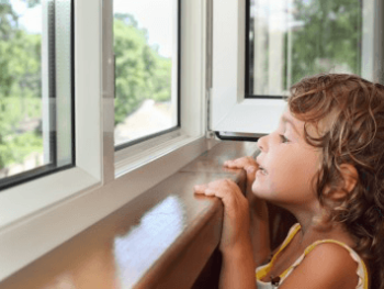 Child looking out new window
