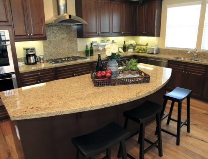 granite_kitchen_countertop_island_dark_wood_cabinets_shutterstock_53398273