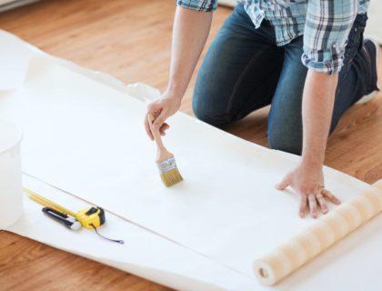 hang_hanging_wallpaper_roll_glue_paste_paintbrush_shutterstock_181133816