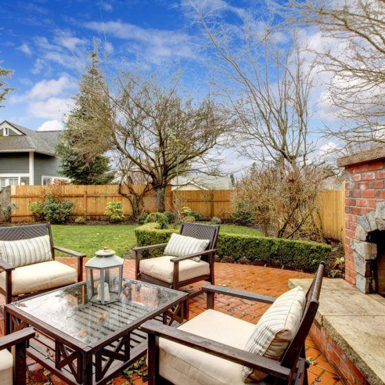 outdoor_fireplace_outdoor_living_entertaining_fall_autumn_patio_furniture_shutterstock_145201945