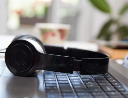 Headphones on laptop keyboard