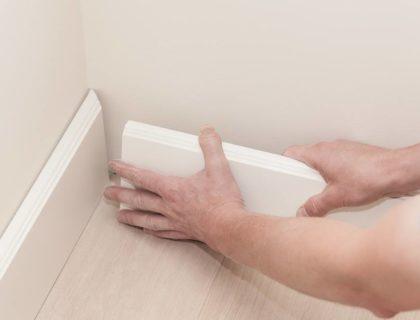 DIY_install_installing_installation_baseboard_trim_shoe_rail_shutterstock_169051385