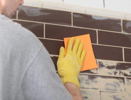 DIY_tile_tiling_backsplash_wall_kitchen_grout_grouting_shutterstock_106053845