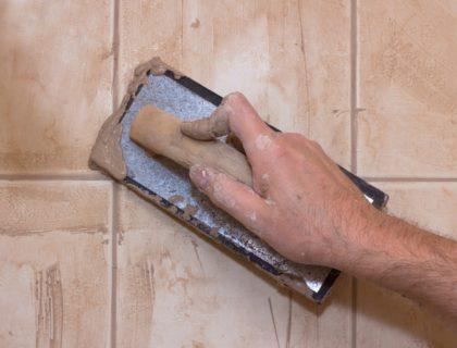 DIY_wall_tile_tiling_ceramic_grout_trowel_shutterstock_91535237