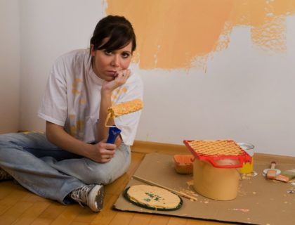 Woman Painting Home of Apartment