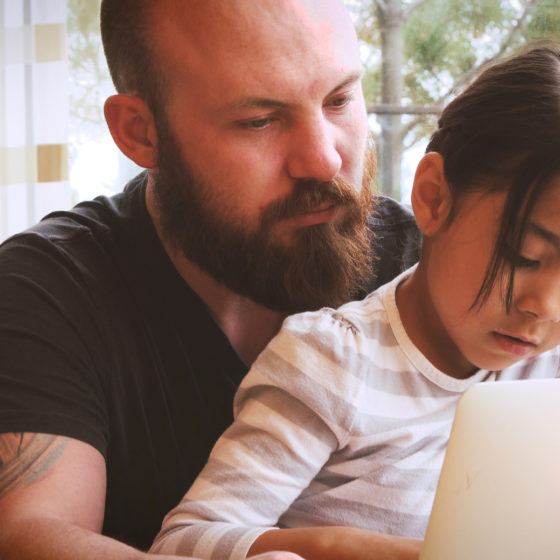 Father and Girl with Laptop