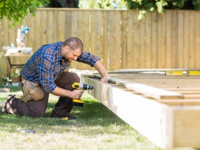 Man building a backyard deck