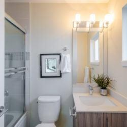 bathroom_toilet_shower_sink_lighting_mirror_small_shutterstock_179944622
