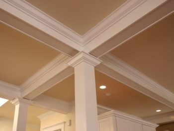 Cracks between crown molding and the wall or ceiling are typically the result of normal expansion and contraction and rarely indicate a structural problem.
