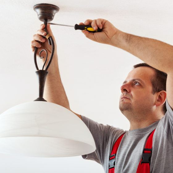 electrician_installing_installation_ceiling_lighting_light_fixture_shutterstock_174701849