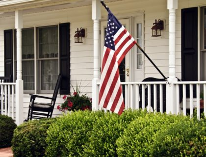 front_porch_veranda_railing_balustrade_columns_american_flag_flag_day_4th_july_fourth_shutterstock_146530919