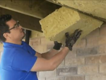 Man insulating basement box beam