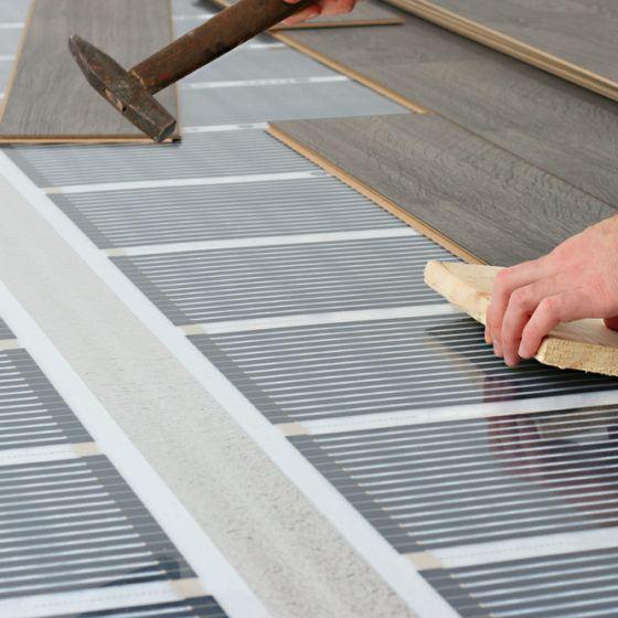 laminate_floor_flooring_install_installing_installation_carbon_infrared_heat_heating_shutterstock_97794677