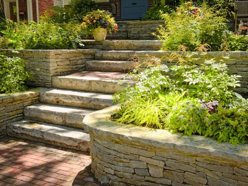 Stone retaining wall, steps and brick walkway