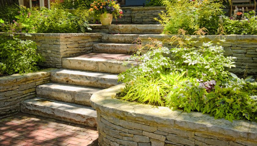 landscaping_landscape_garden_flowers_plants_stone_steps_stairs_ledges_stonescape_hardscape_hardscaping_shutterstock_56460916