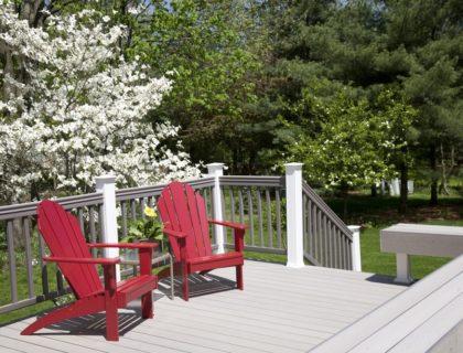 decking, outdoors_outdoor_living_backyard_composite_deck_decking_landscaping_trees_chairs_shutterstock_12218524