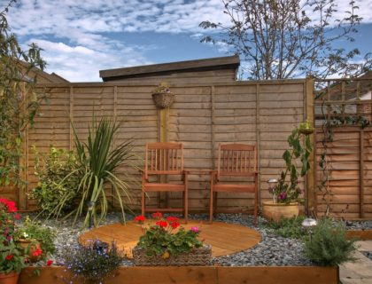 privacy_screen_gravel_container_garden_low_maintenance_landscape_landcaping_yard_shutterstock_39691354