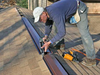 Man installing ridge vent