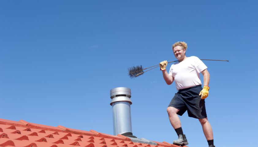 roof_chimney_clean_sweep_sweeper_shutterstock_126939692
