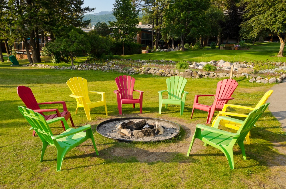 Chairs around a backyard fire pit