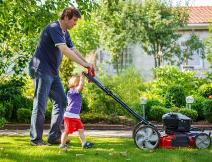 shutterstock_147677615fathersonmowing