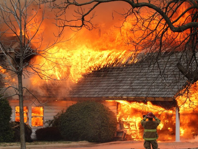 House on fire with fireman