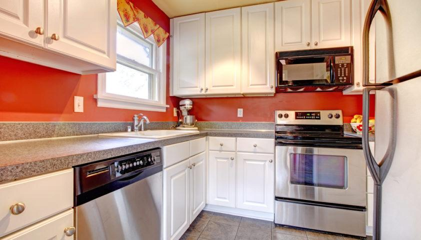 small_kitchen_white_cabinets_tile_floor_shutterstock_179543618