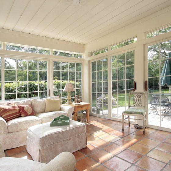 sunroom_sun_room_patio_windows_sunlight_stone_tile_floor_shutterstock_37599121