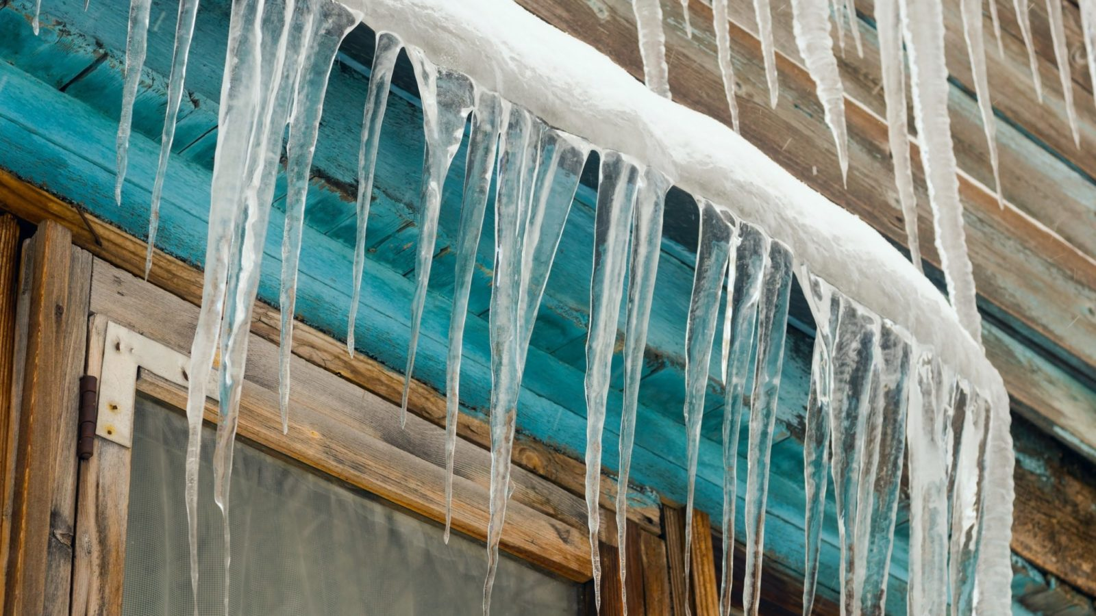 icicles form on siding