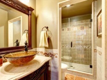 vanity, Bathroom interior in luxury house. Rich bathroom vanity cabinet with vessel sink and mirror. View of shower. Northwest, USA