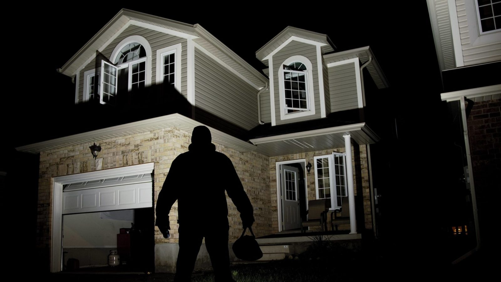 Burglar looking at a home.