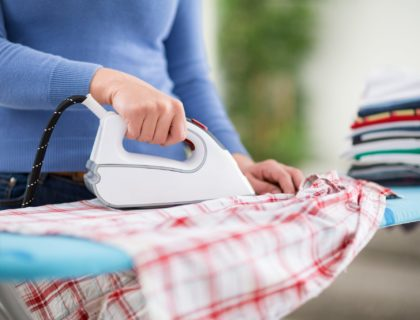 Woman from ironing services iron clothes.
